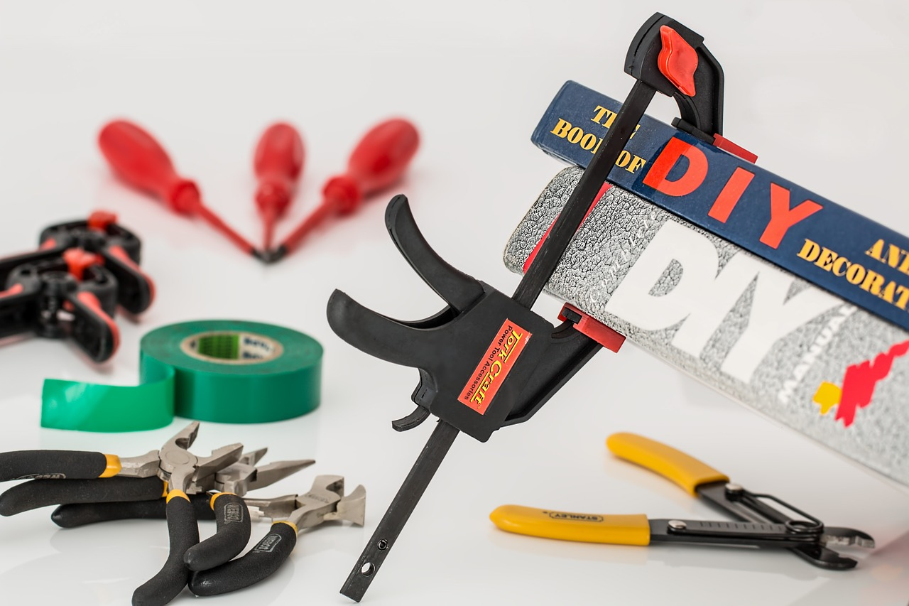 "home improvement tools with ""DIY"" sign"