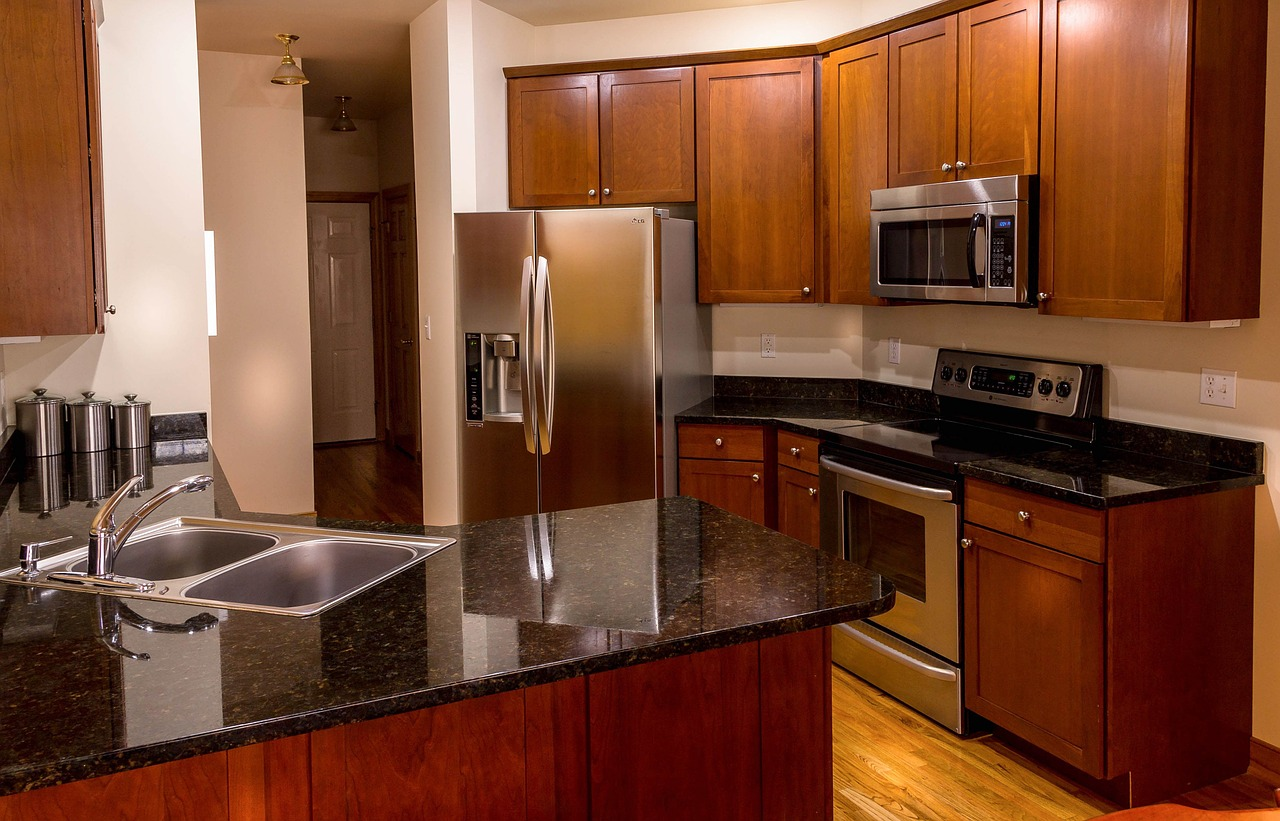 upgraded kitchen with granite countertops and stainless steel appliances