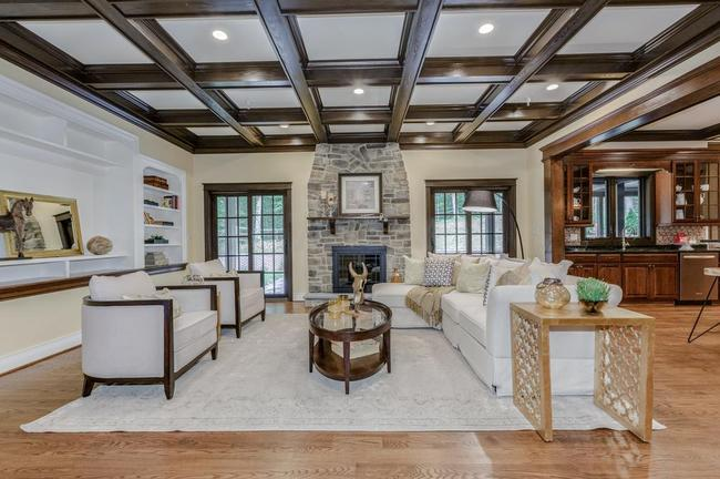 large living room with exposed beams