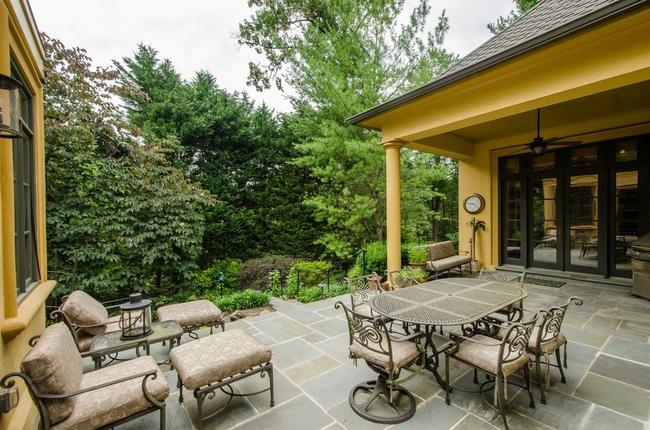 patio and wooded backyard at 9120 Kittery Lane in Bethesda
