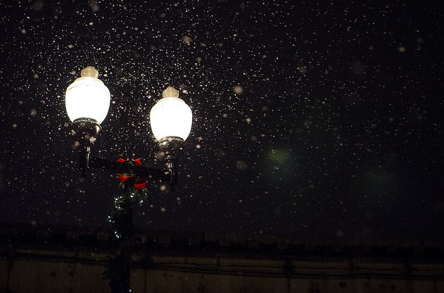 holiday street lamp in the snow at night
